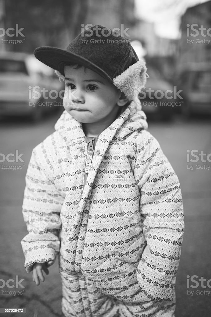 Baby in winter clothes stock photo