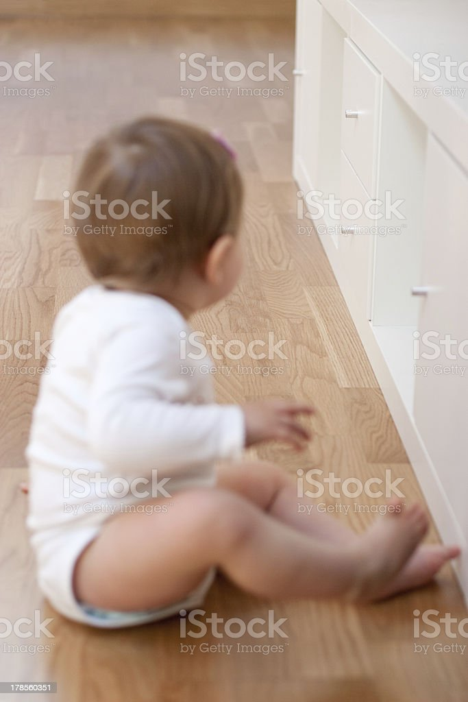 Baby is going to open a drawer stock photo