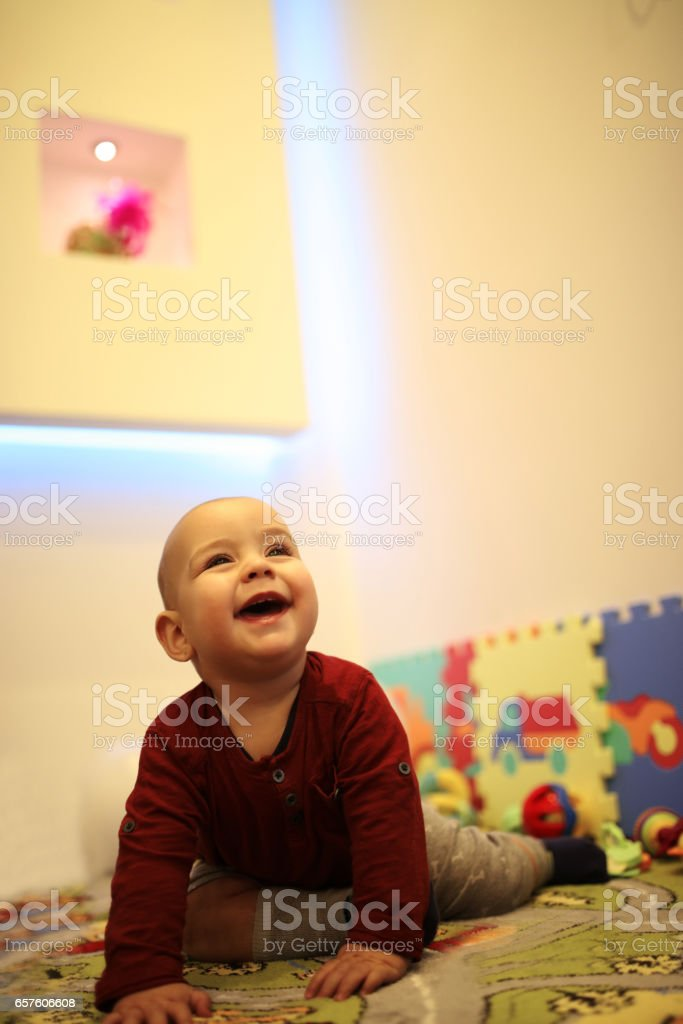 Baby is playing stock photo