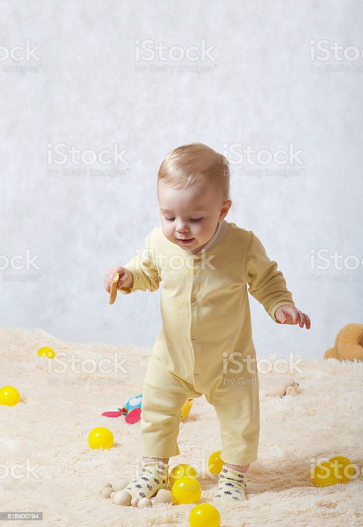 Baby  is trying to make her first steps stock photo