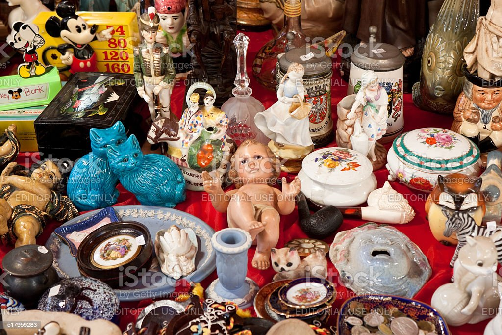 Baby Jesus doll and other vintage things on flea market stock photo