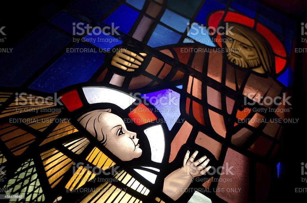 Baby Jesus in a manger on stained glass royalty-free stock photo