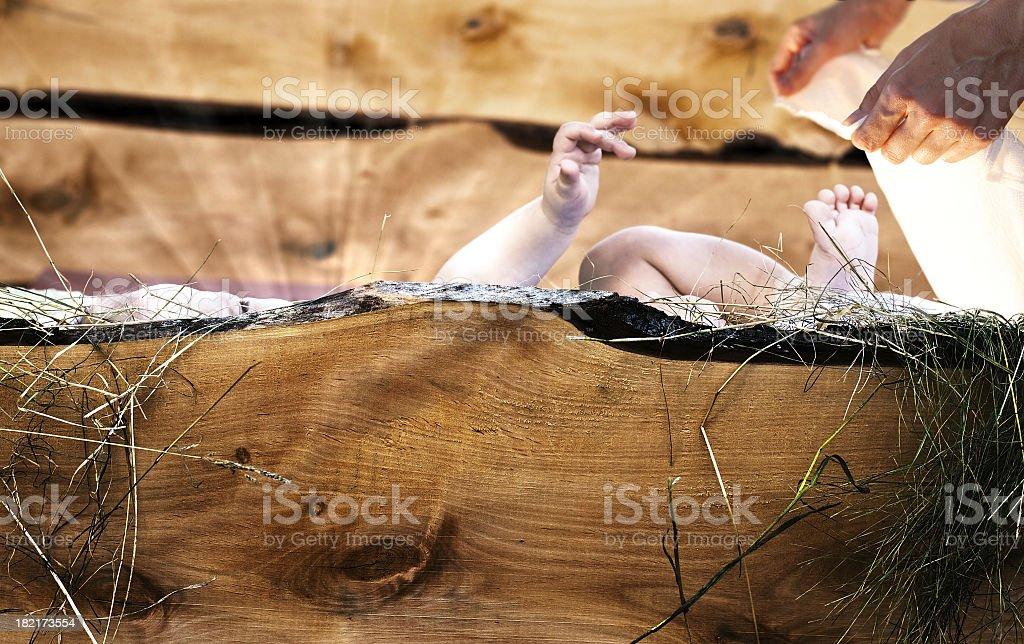 Baby Jesus lying in wooden crib. stock photo