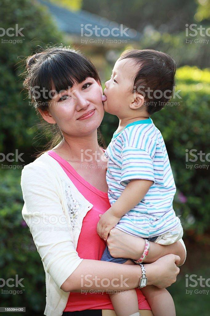 Baby kiss royalty-free stock photo
