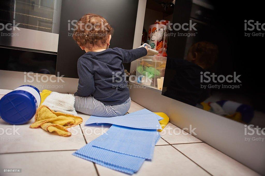 Baby kitchen dangers stock photo