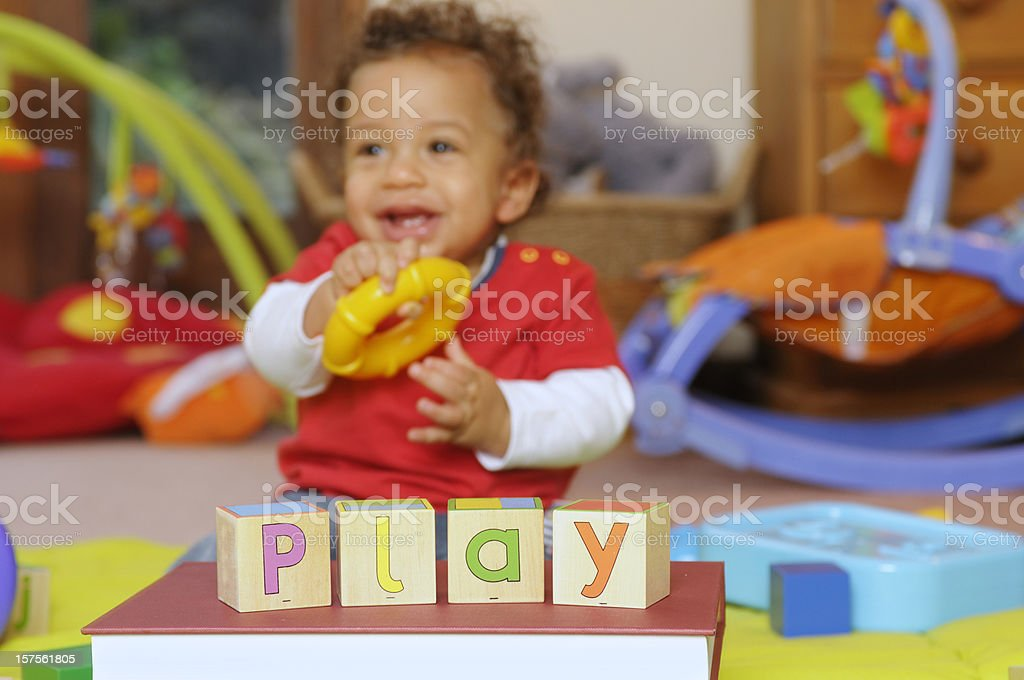 Baby learning though play stock photo