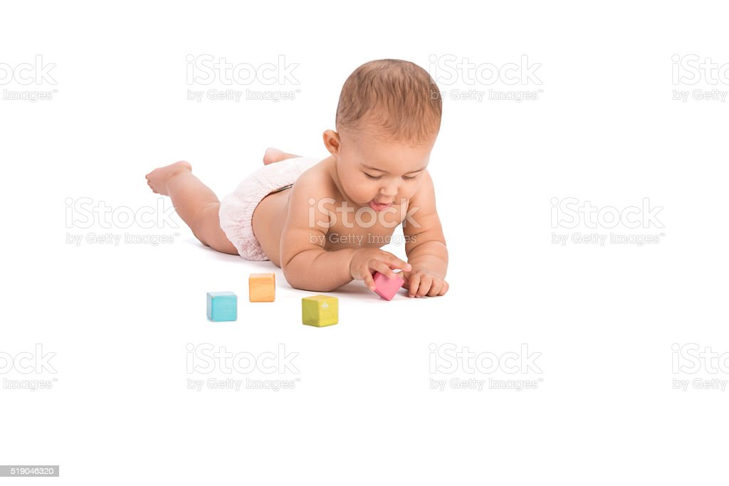 Baby learns to grasp and pick up objects. stock photo