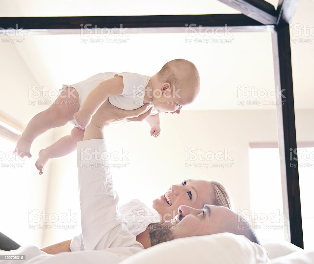 Baby lifted up by father's hand royalty-free stock photo