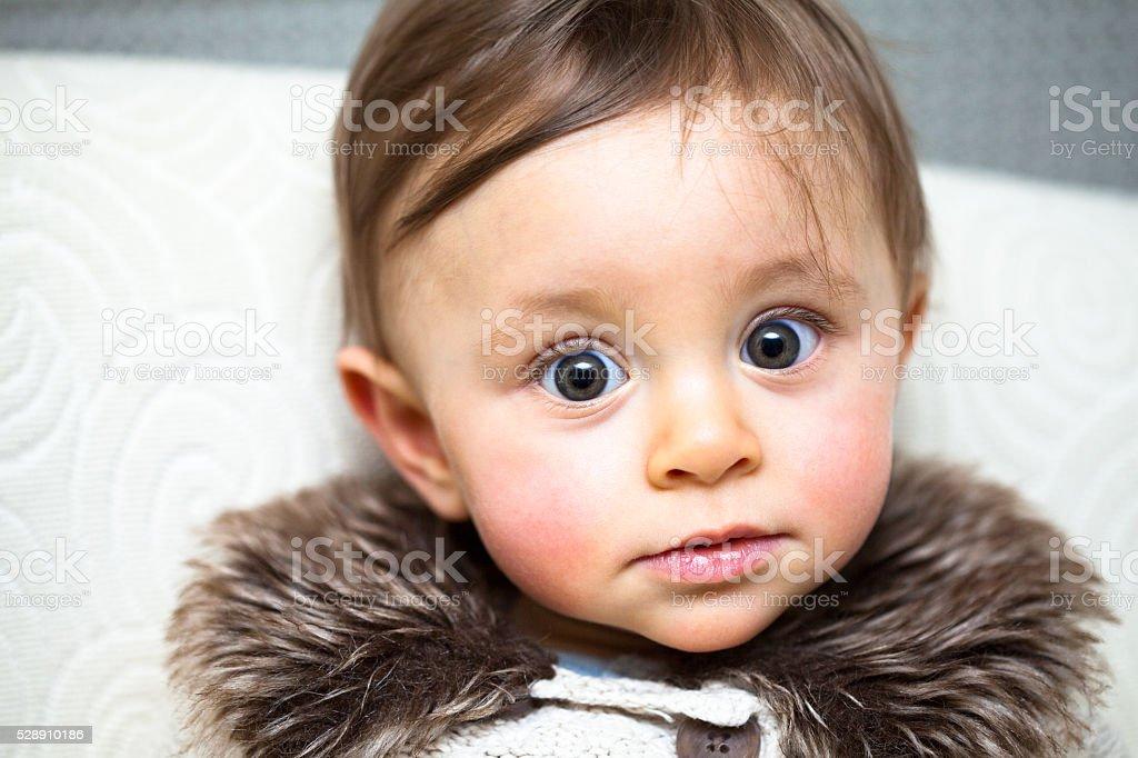Baby light hair and big green eyes stock photo