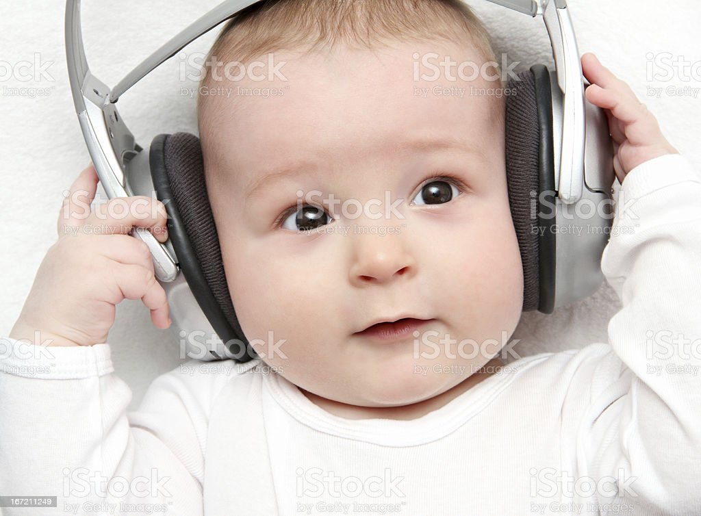 baby listening music on back royalty-free stock photo