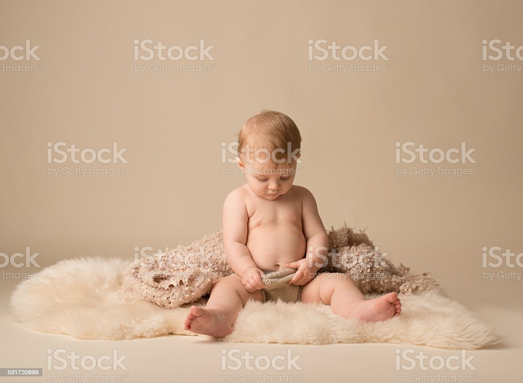 Baby Looking in Diaper stock photo