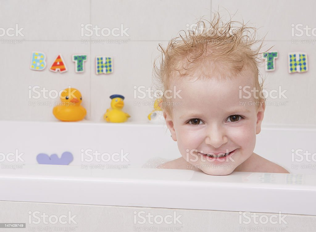 Baby looking out of the bath royalty-free stock photo