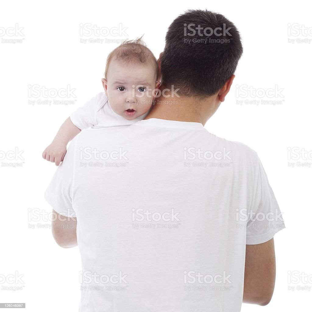 Baby looking over father's shoulder stock photo