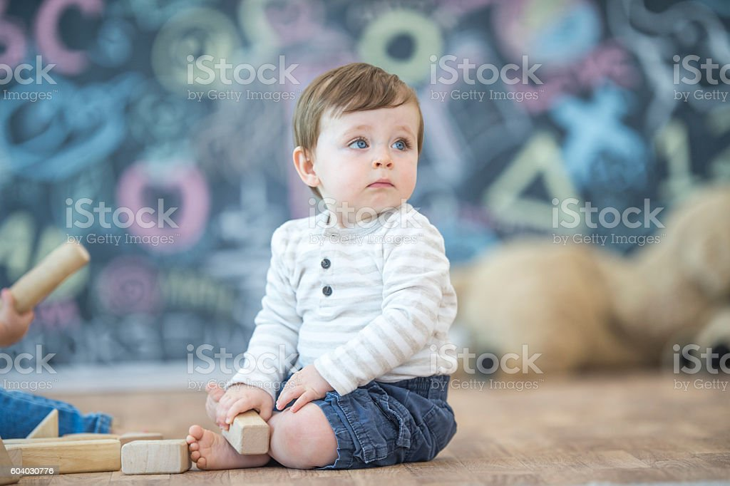 Baby looking up at Friends stock photo