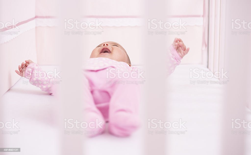 Baby lying on bed. royalty-free stock photo