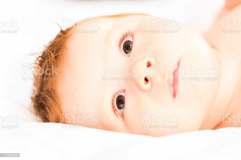 Baby lying on side royalty-free stock photo