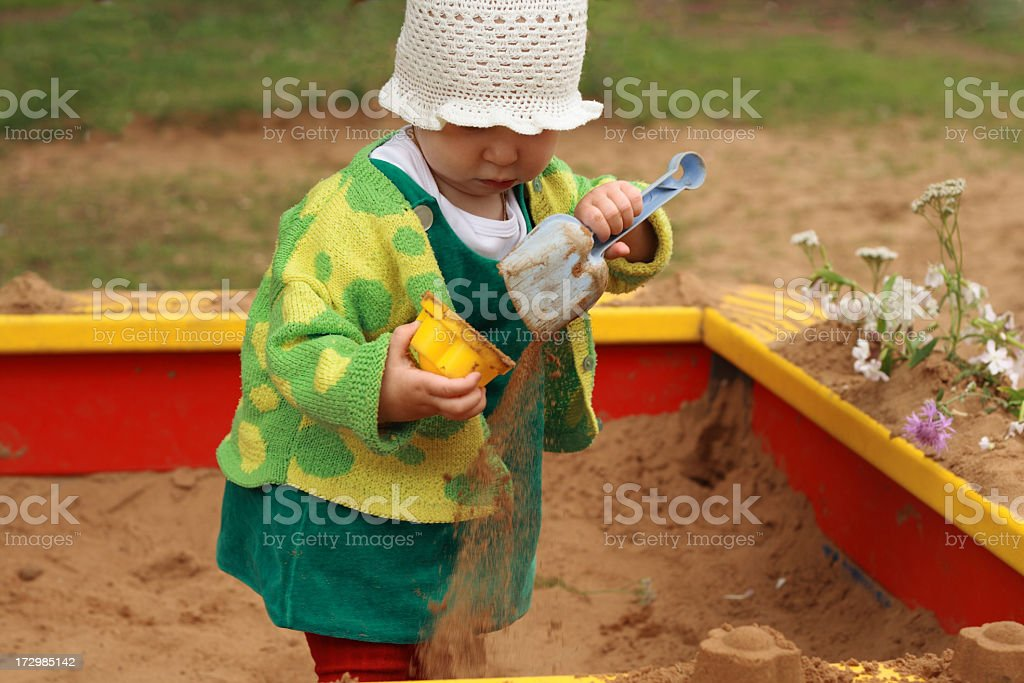 baby makes pies of sand royalty-free stock photo