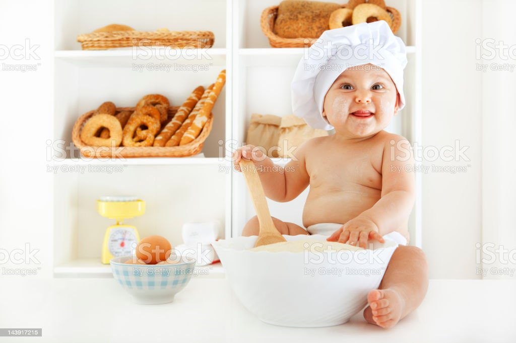 Baby Making Dough For Baking royalty-free stock photo