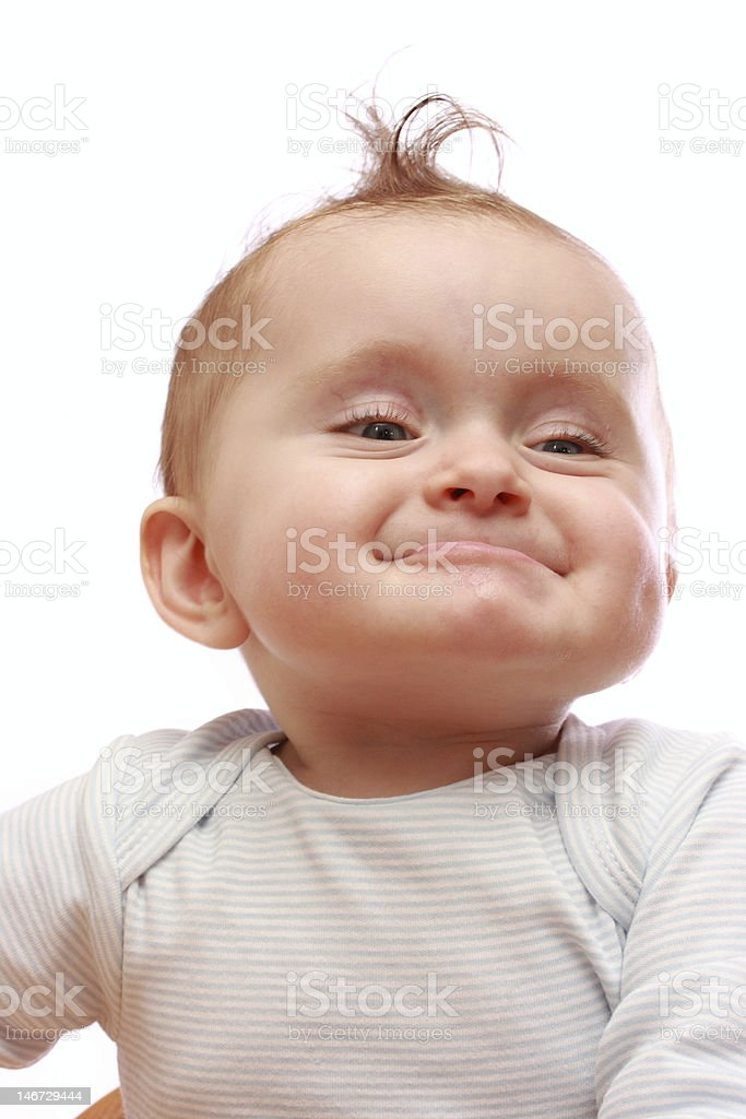 A baby making funny facial expressions royalty-free stock photo