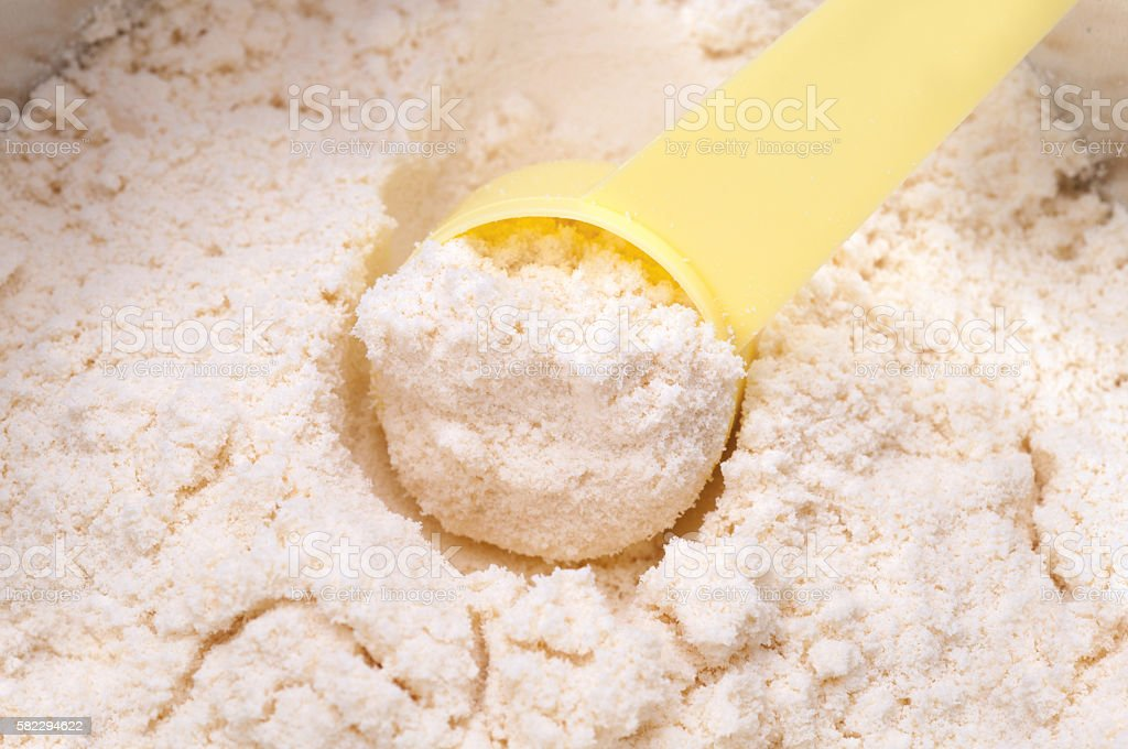 baby milk powder in cans that open with a spoon stock photo