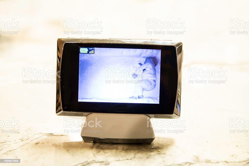 Baby monitor screen with sleeping baby stock photo