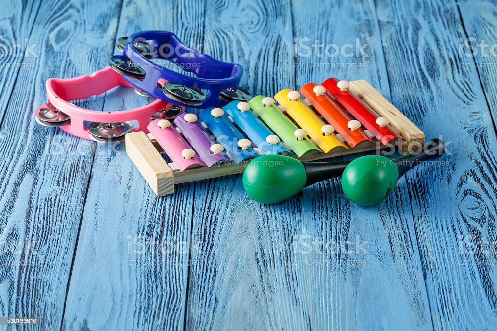 Baby musical instruments collection maracas, xylophone and tambo stock photo