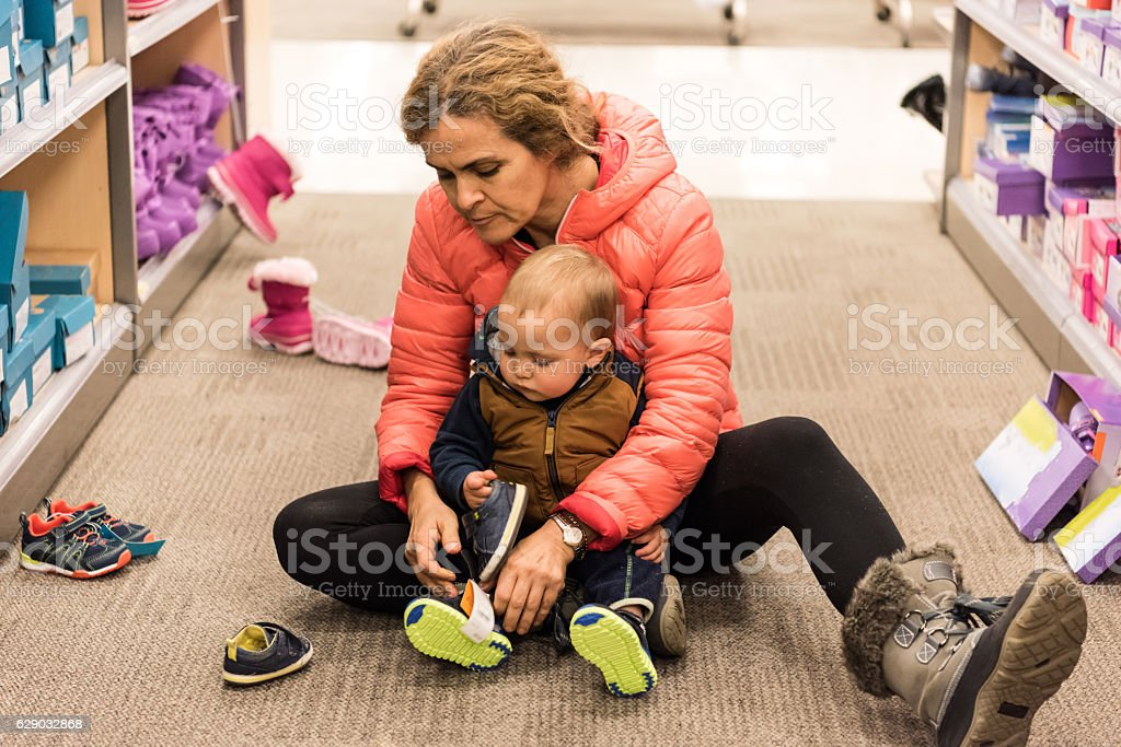 Baby Needs New Shoes stock photo