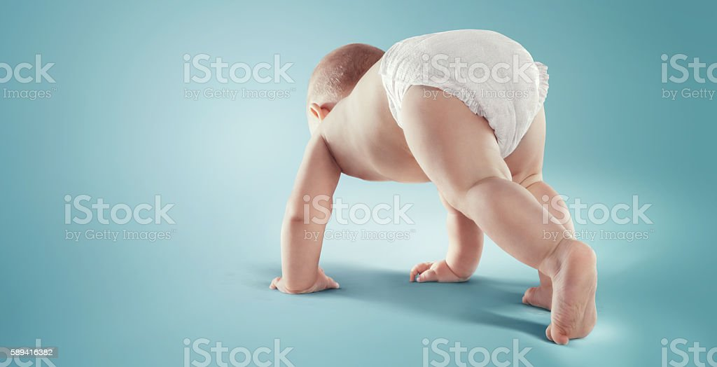 Baby. Newborn in the diaper. Isolated stock photo