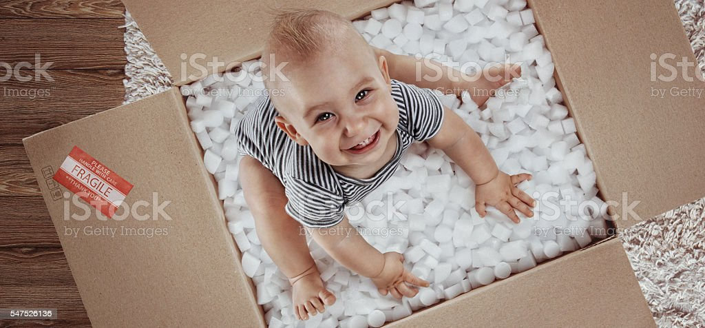 Baby. Newborn in the post parcel. Top view stock photo