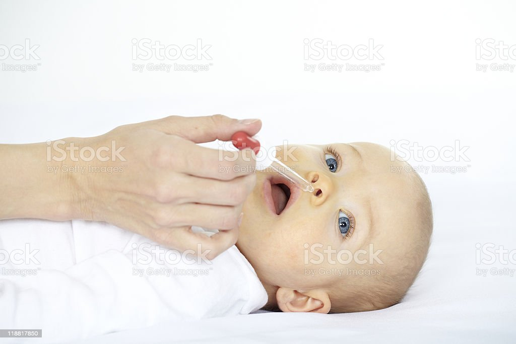 baby nosedrops stock photo