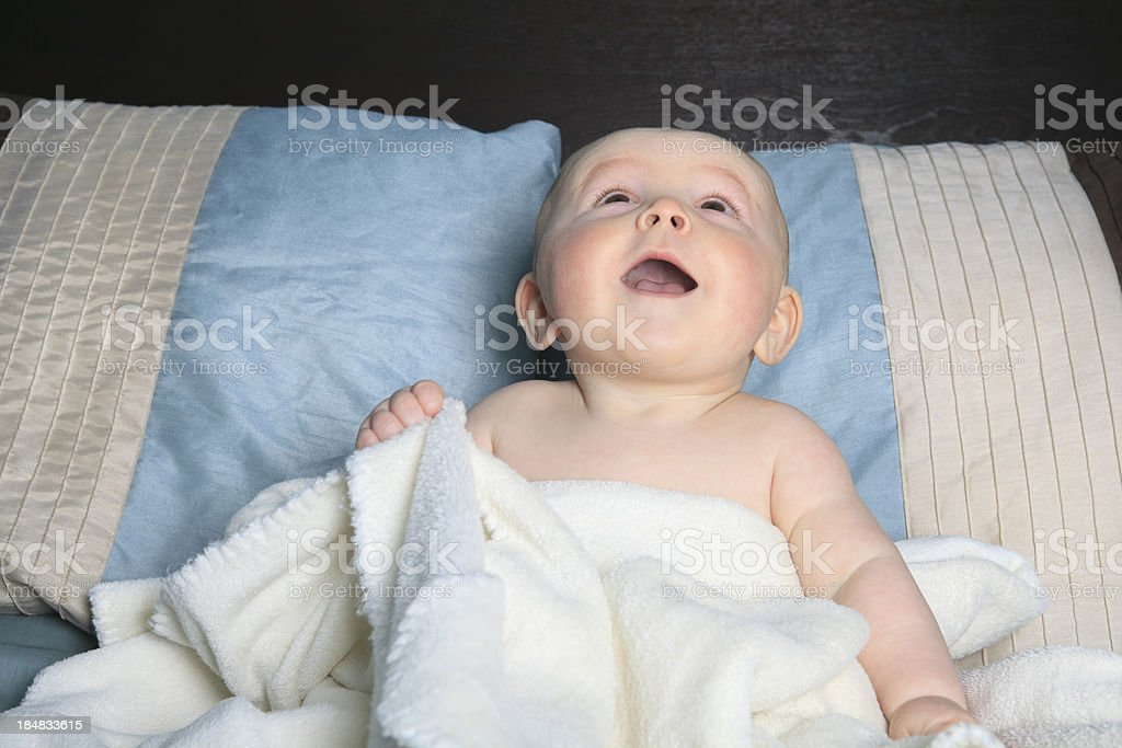 Baby on Adult Bed stock photo
