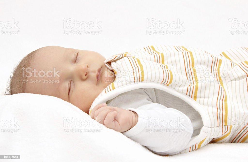 baby on back in sleeping bag stock photo