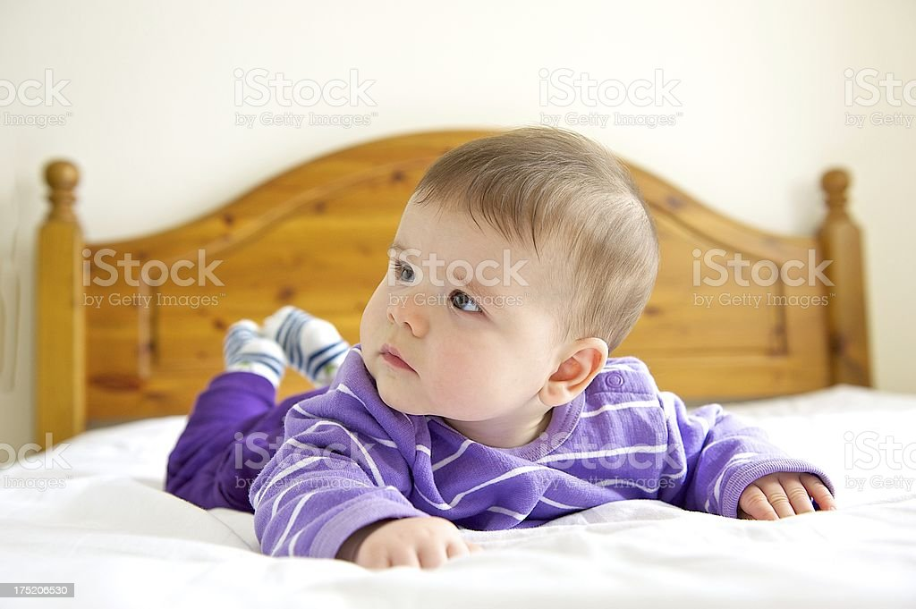 Baby on bed royalty-free stock photo