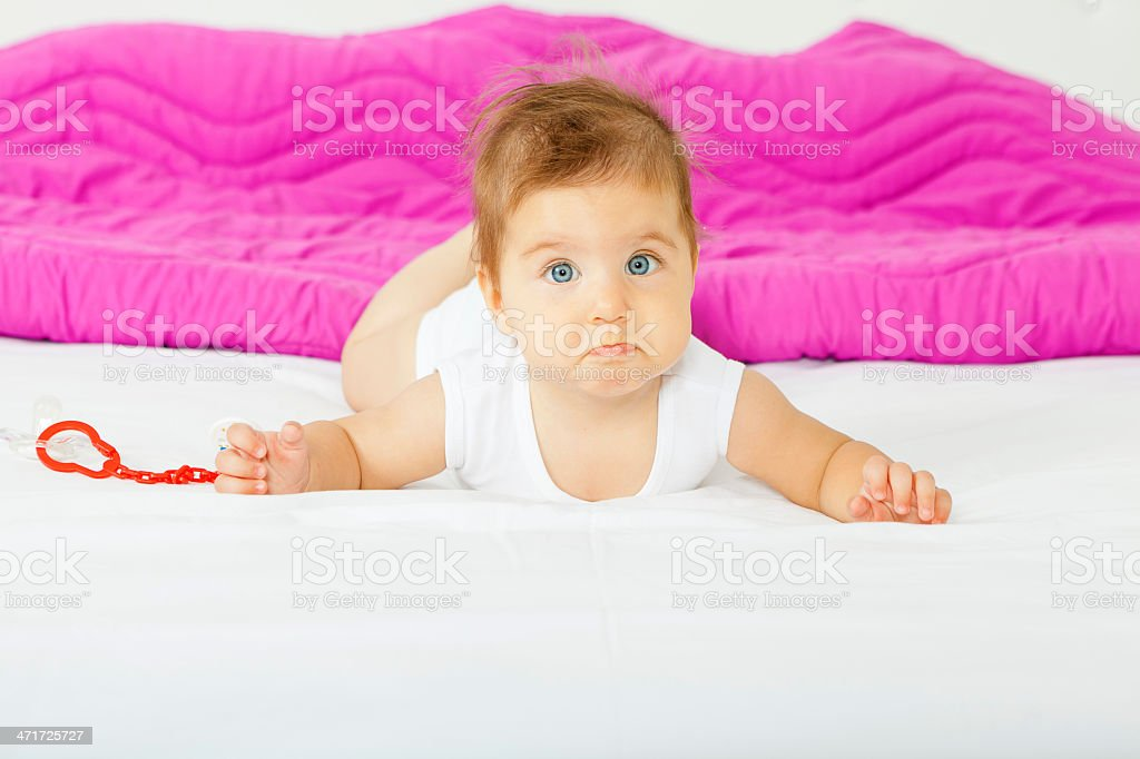 Baby on bed with sad face royalty-free stock photo