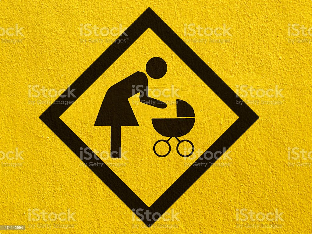 Baby on board painted on a stucco wall outside stock photo
