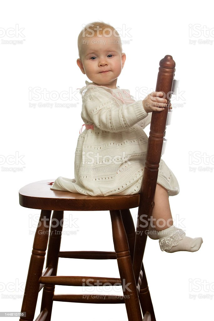 Baby on chair. stock photo