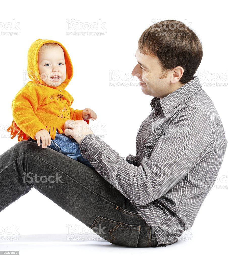 Baby on daddy's knees royalty-free stock photo
