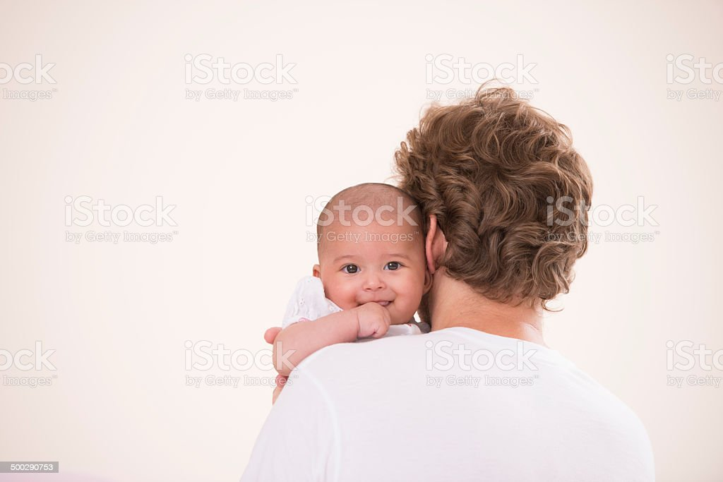 Baby on fathers arms. stock photo