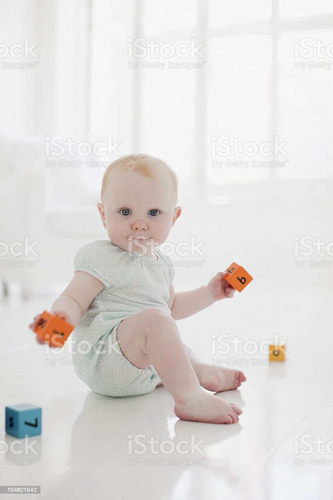 Baby on floor with wood blocks royalty-free stock photo