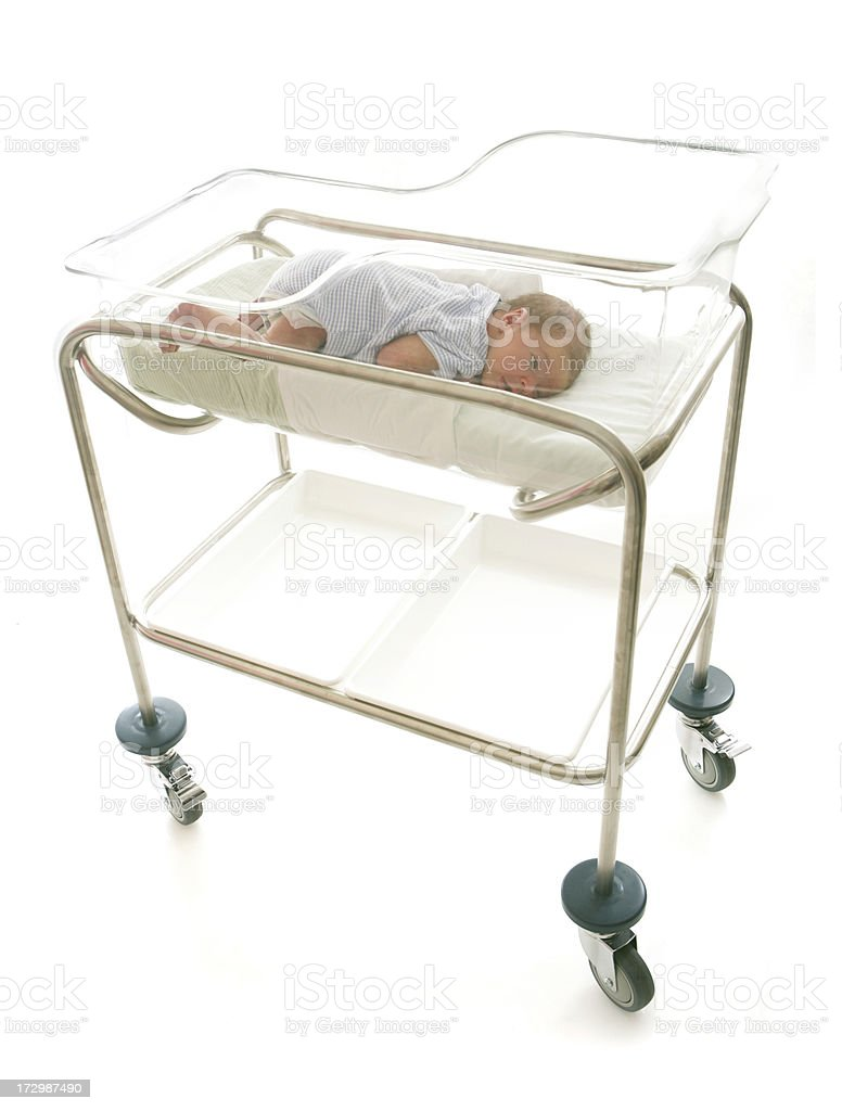 Baby on Front in Crib stock photo