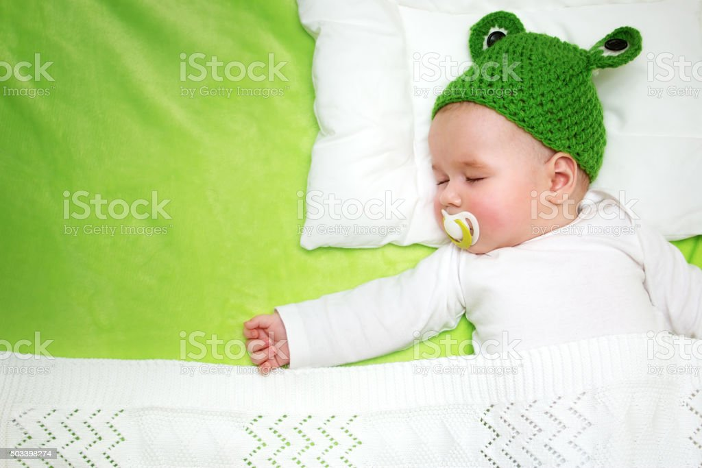 Baby  on green blanket stock photo