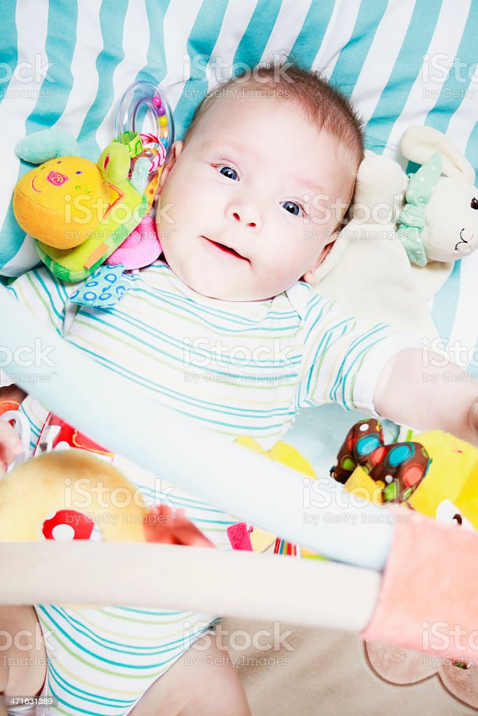 Baby on his playmat stock photo