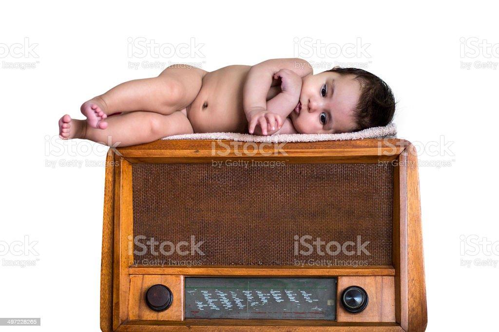 Baby on old vintage radio royalty-free stock photo