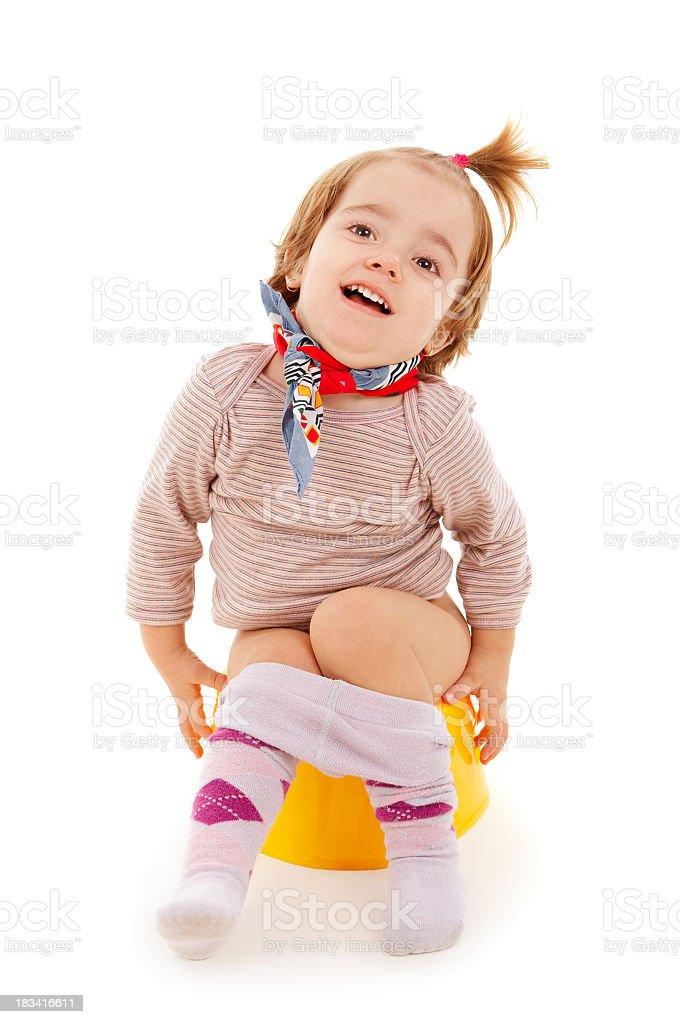 Baby on potty stock photo