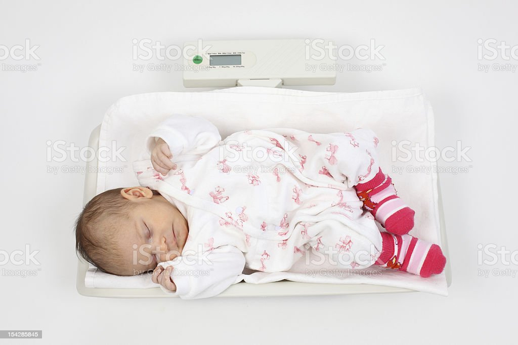 Baby on scales stock photo