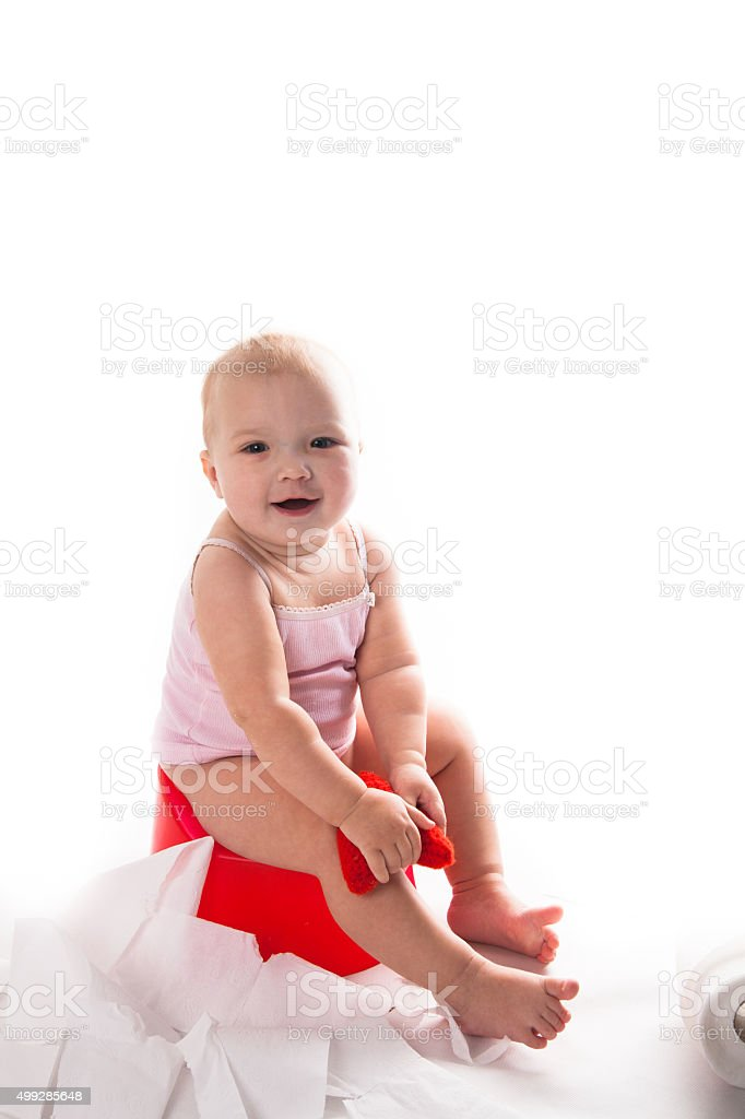 baby on the pot, white background stock photo