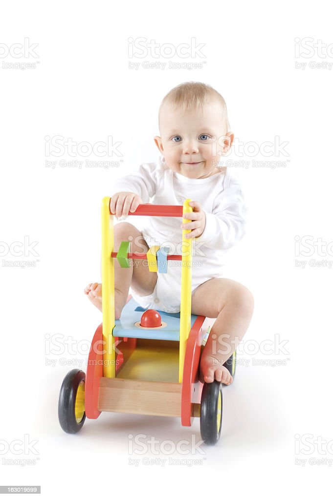 Baby on toy car stock photo