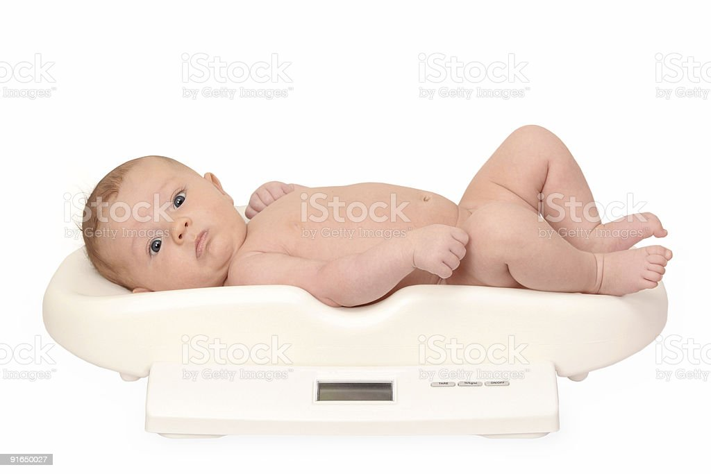 baby on weight scale stock photo