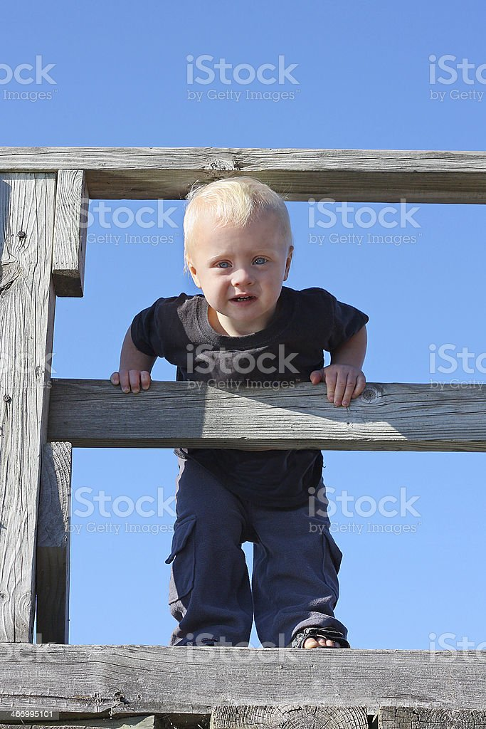Baby on Wooden Bridge royalty-free stock photo