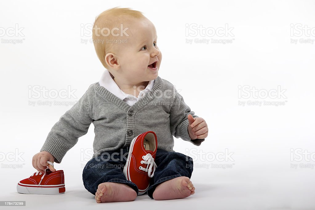 baby or kid with small shoes stock photo